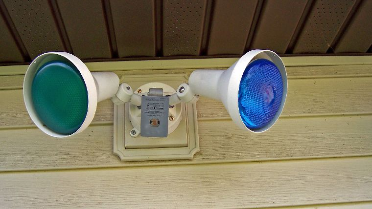 Blue and green outdoor security lights