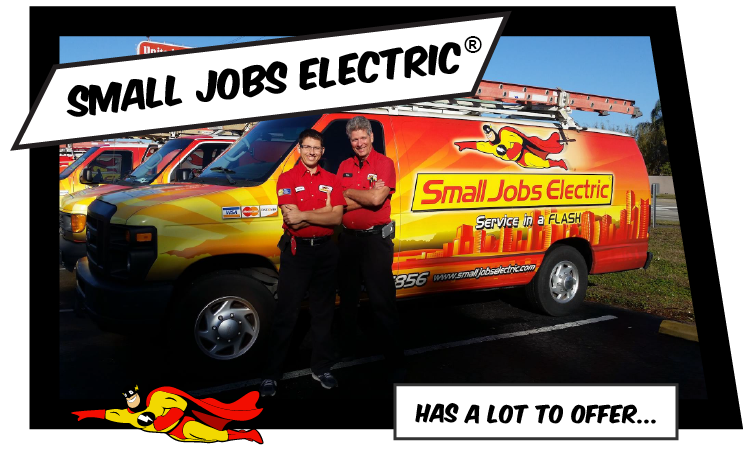 Two electricians from Small Jobs Electric standing in front of their work van.